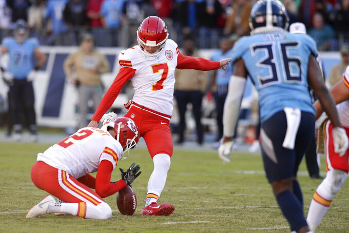 Kansas City Chiefs kicker Harrison Butker (7) kicks a 39-yard field goal against the Tennessee Titans as Dustin Colquitt (2) holds in the second half of an NFL football game Sunday, Nov. 10, 2019, in Nashville, Tenn. (AP Photo/Mark Zaleski)