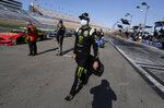 Kurt Busch arrives at the track before a NASCAR Cup Series auto race, Sunday, Sept. 27, 2020, in Las Vegas. (AP Photo/Isaac Brekken)