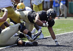 Wake Forest's Matt Colburn, right, dives into the end zone for a touchdown against Notre Dame in the first half of an NCAA college football game in Winston-Salem, N.C., Saturday, Sept. 22, 2018. (AP Photo/Chuck Burton)