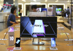 Samsung Electronics' Galaxy S10+ smartphones are displayed at its shop in Seoul, South Korea, Friday, July 5, 2019. Samsung Electronics Co. said Friday its operating profit for the last quarter likely fell more than 56% from a year earlier amid a weak market for memory chips. (AP Photo/Ahn Young-joon)