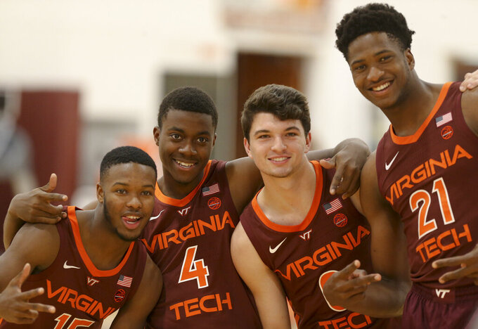 In this Tuesday, Oct. 22, 2019 photo, Virginia Tech freshmen, from left; Jalen Cone (15) Nahiem Alleyne (4) Hunter Cattoor (0) and John Ojiako (21) pose for a photograph during NCAA college basketball practice in Blacksburg, Va. (Matt Gentry/The Roanoke Times via AP)