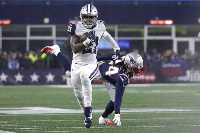 Dallas Cowboys running back Ezekiel Elliott carries the ball as he leaves New England Patriots cornerback Stephon Gilmore behind in the first half of an NFL football game, Sunday, Nov. 24, 2019, in Foxborough, Mass. (AP Photo/Elise Amendola)