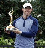Rory McIlroy, of Northern Ireland, smiles as he holds the trophy for winning The Players Championship golf tournament Sunday, March 17, 2019, in Ponte Vedra Beach, Fla. (AP Photo/Lynne Sladky)