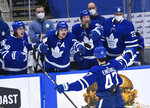 Toronto Maple Leafs forward Pierre Engvall (47) celebrates his goal against the Montreal Canadiens with Mitchell Marner (16), Auston Matthews (34), Joe Thornton (97) and David Rittich (33) during the second period of an NHL hockey game Saturday, May 8, 2021, in Toronto. (Nathan Denette/The Canadian Press via AP)