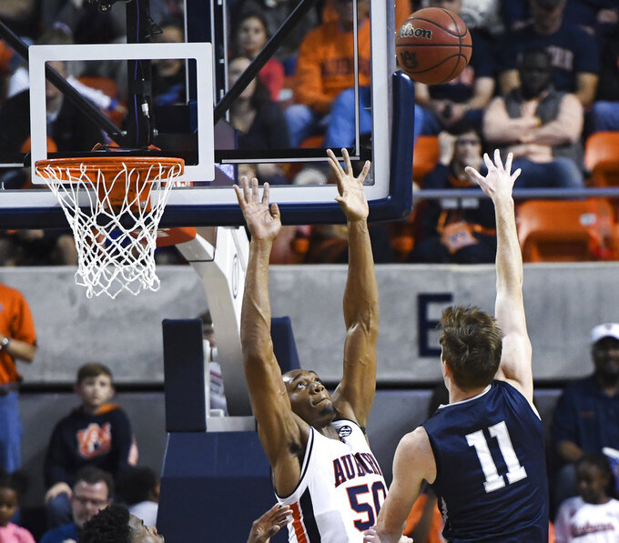 North Florida player Garrett Sams (11) shoots over Auburn center Austin Wiley (50) during the second half of an NCAA college basketball game Saturday, Dec. 29, 2018, in Auburn, Ala. (AP Photo/Julie Bennett)