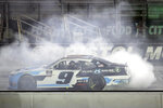 Noah Gragson (9) does a burnout after winning a NASCAR Xfinity Series auto race at Bristol Motor Speedway Monday, June 1, 2020, in Bristol, Tenn. (AP Photo/Mark Humphrey)