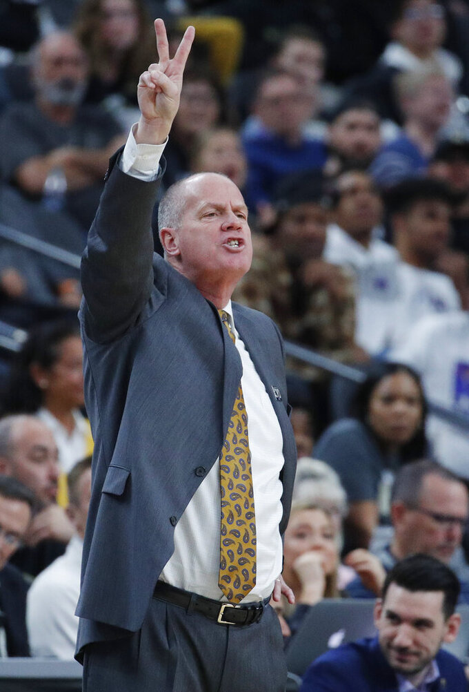 Colorado coach Tad Boyle motions to his players during the second half of the team's NCAA college basketball game against Oregon State in the quarterfinals of the Pac-12 men's tournament Thursday, March 14, 2019, in Las Vegas. (AP Photo/John Locher)