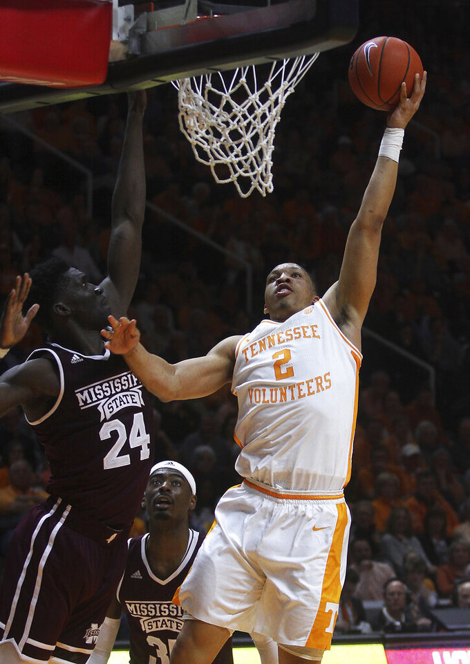 Tennessee's Grant Williams shoots next to Mississippi State's Abdul Ado during an NCAA college basketball game Tuesday, March 5, 2019, in Knoxville, Tenn. (Tom Sherlin/The Daily Times via AP)