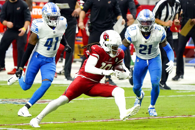 Arizona Cardinals wide receiver DeAndre Hopkins (10) runs after the catch as Detroit Lions defensive back Tracy Walker (21) and cornerback Chris Jones pursue during the second half of an NFL football game, Sunday, Sept. 27, 2020, in Glendale, Ariz. (AP Photo/Rick Scuteri)