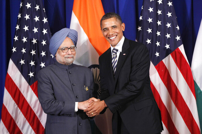 FILE - In this Nov. 18, 2011 file photo, U.S. President Barack Obama meets with India's Prime Minister Manmohan Singh on the sidelines of the ASEAN and East Asia summit in Nusa Dua, Bali, Indonesia. On Friday, Jan. 20, 2020, The Associated Press reported on a manipulated version of a photo similar to this circulating online incorrectly depicting Obama with Iranian President Hassan Rouhani. The manipulated image has circulated on social media and blogs since at least 2013. (AP Photo/Charles Dharapak)