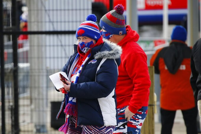 Buffalo Bills fans arrive at Bills Stadium for an NFL wild-card playoff football game against the Indianapolis Colts Saturday, Jan. 9, 2021, in Orchard Park. (AP Photo/Jeffrey T. Barnes)