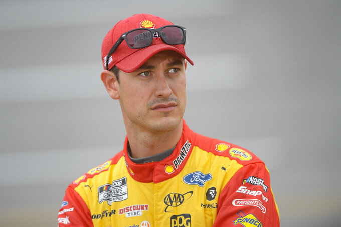 Joey Logano waits to get in his car for a NASCAR Cup series auto race Sunday, Oct. 3, 2021, in Talladega, Ala. (AP Photo/John Amis)