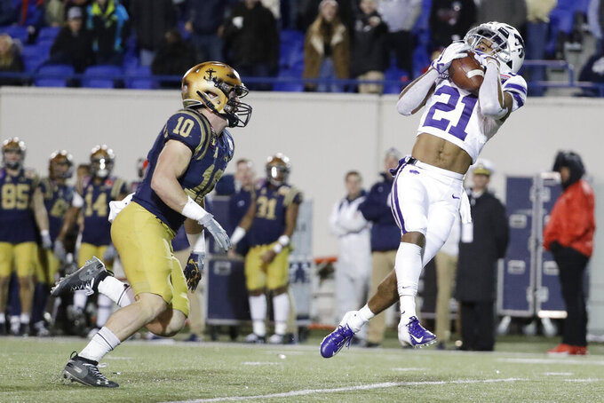 Kansas State wide receiver Wykeen Gill (21) catches a pass ahead of Navy safety Kevin Brennan (10) for a 42-yard gain in the second half of the Liberty Bowl NCAA college football game Tuesday, Dec. 31, 2019, in Memphis, Tenn. Navy won 20-17. (AP Photo/Mark Humphrey)