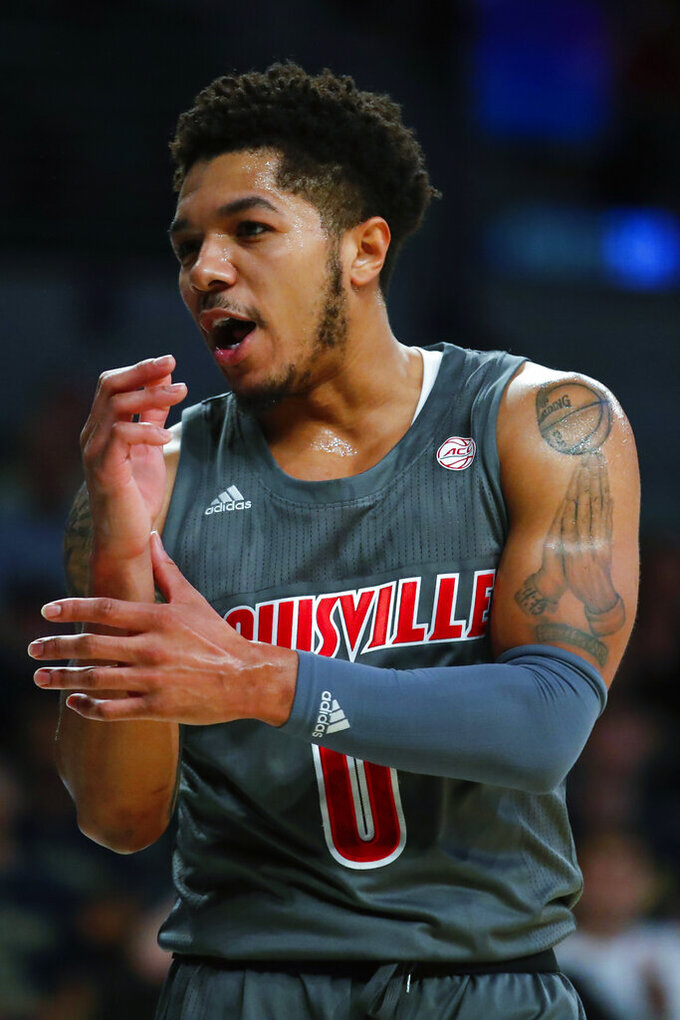 Louisville guard Lamarr Kimble (0) argues towards a referee during the first half of an NCAA college basketball game against Georgia Tech in Atlanta, Wednesday, Feb. 12, 2020. (AP Photo/Todd Kirkland)