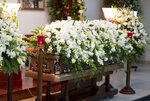 The coffin containing the remains of television astrologer Walter Mercado is blanketed with lilies and roses during a public wake, in the Santurce neighborhood, San Juan, Puerto Rico, Wednesday, Nov. 6, 2019. Mercado, whose glamorous persona made him a star in Latin media and a cherished icon for gay people in most of the Spanish-speaking world, died Saturday. He was 88. (AP Photo/Carlos Giusti)