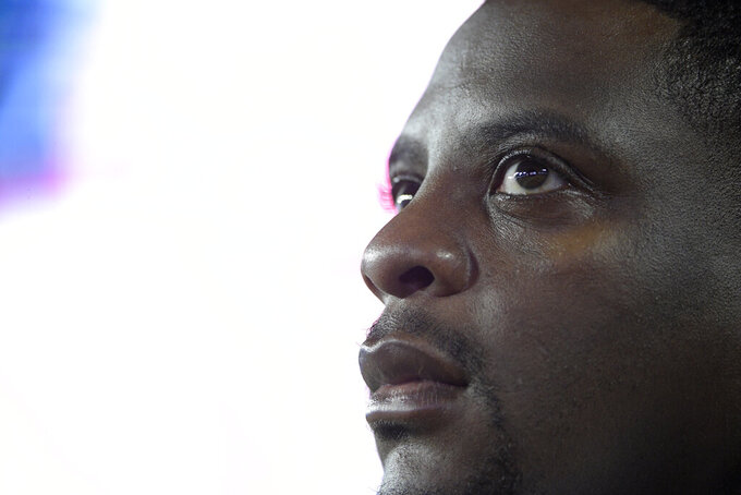 FILE - In this Aug. 31, 2017, file photo, Washington Redskins radio analyst and former running back Clinton Portis watches from the sideline during the second half of an NFL preseason football game against the Tampa Bay Buccaneers in Tampa, Fla. Former NFL players Clinton Portis, Tamarick Vanover and Robert McCune pleaded guilty for their roles in a nationwide healthcare fraud scheme, the U.S. Department of Justice announced Tuesday, Sept. 7, 2021.. (AP Photo/Phelan M. Ebenhack, File)