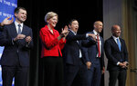 Democratic presidential candidates South Bend, Ind., Mayor Pete Buttigieg, from left, Sen. Elizabeth Warren, D-Mass., businessman Andrew Yang, Sen. Cory Booker, D-N.J., and former Maryland Rep. John Delaney stand onstage during a fundraiser for the Nevada Democratic Party, Sunday, Nov. 17, 2019, in Las Vegas. (AP Photo/John Locher)