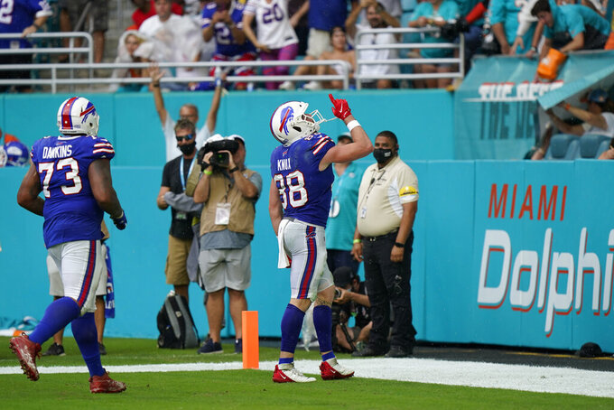 Buffalo Bills tight end Dawson Knox (88) celebrates after scoring a touchdown during the second half of an NFL football game, Sunday, Sept. 19, 2021, in Miami Gardens, Fla. (AP Photo/Wilfredo Lee)
