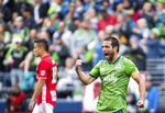 Seattle Sounders midfielder Nicolas Lodeiro, right, celebrates a goal against the New York Red Bulls, Sunday, Sept. 15, 2019, in the second half of an MLS soccer match at CenturyLink Field in Seattle, Wash. (Joshua Bessex/The News Tribune via AP)