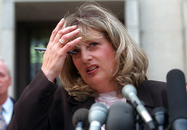 FILE - In this July 29, 1998 file photo Linda Tripp talks to reporters outside federal court in Washington. Tripp, whose secretly recorded conversations with White House intern Monica Lewinsky led to the 1998 impeachment of President Bill Clinton, died Wednesday, April 8, 2020, at age 70. (AP Photo/Khue Bui, File)