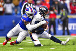 Buffalo Bills defensive end Shaq Lawson (90) sacks Denver Broncos quarterback Brandon Allen (2) during the fourth quarter of an NFL football game, Sunday, Nov. 24, 2019, in Orchard Park, N.Y. (AP Photo/Adrian Kraus)