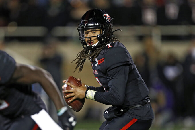 Texas Tech's Jett Duffey (7) drops back to pass the ball during the first half of an NCAA college football game against Kansas State, Saturday, Nov. 23, 2019, in Lubbock, Texas. (Brad Tollefson/Lubbock Avalanche-Journal via AP)