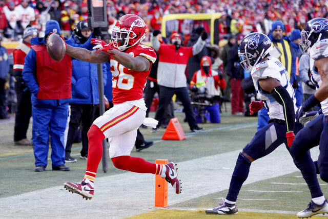Kansas City Chiefs' Damien Williams runs for a touchdown during the second half of the NFL AFC Championship football game against the Tennessee Titans Sunday, Jan. 19, 2020, in Kansas City, MO. (AP Photo/Charlie Neibergall)