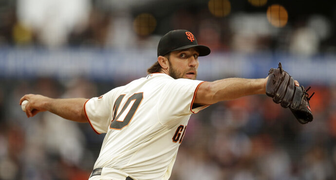 San Francisco Giants pitcher Madison Bumgarner works against the New York Mets during the first inning of a baseball game Thursday, July 18, 2019, in San Francisco. (AP Photo/Ben Margot)