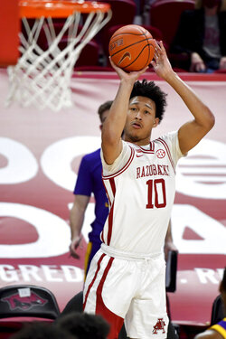 Arkansas forward Jaylin Williams (10) shoots against LSU during the first half of an NCAA college basketball game in Fayetteville, Ark. Saturday, Feb. 27, 2021. (AP Photo/Michael Woods)
