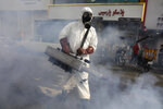 A firefighter disinfects a square against the new coronavirus, in western Tehran, Iran, Friday, March 13, 2020. The new coronavirus outbreak has reached Iran's top officials, with its senior vice president, Cabinet ministers, members of parliament, Revolutionary Guard members and Health Ministry officials among those infected. The vast majority of people recover from the new coronavirus. According to the World Health Organization, most people recover in about two to six weeks, depending on the severity of the illness. (AP Photo/Vahid Salemi)