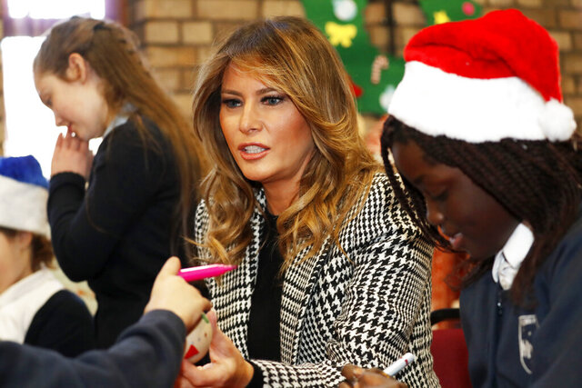 First lady Melania Trump joins local school students creating holiday decorations at the Salvation Army Clapton Center in London, Wednesday, Dec. 4, 2019. (AP Photo/Alastair Grant, Pool)