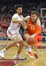 Clemson forward David Skara (24) attempts to drive past the defense of Louisville forward Jordan Nwora (33) during the first half of an NCAA college basketball game in Louisville, Ky., Saturday, Feb. 16, 2019. (AP Photo/Timothy D. Easley)