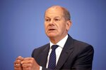 Federal Minister of Finance Olaf Scholz attends a press conference on federal flood aid in Berlin, Germany, Wednesday, July 21, 2021. (AP Photo/Axel Schmidt, Pool)