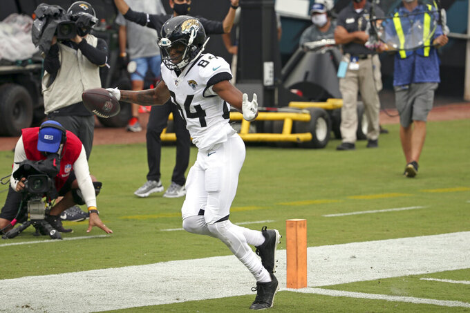Jacksonville Jaguars wide receiver Keelan Cole scores a touchdown off a 22-yard pass play against the Indianapolis Colts during the second half of an NFL football game, Sunday, Sept. 13, 2020, in Jacksonville, Fla. (AP Photo/Stephen B. Morton)