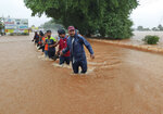 National Disaster Response Force personnel rescue people stranded in floodwaters in Kolhapur, in the western Indian state of Maharashtra, Friday, July 23, 2021. Landslides triggered by heavy monsoon rains hit parts of western India, killing at least 32 people and leading to the overnight rescue of more than 1,000 other people trapped by floodwaters, officials said Friday. (AP Photo)