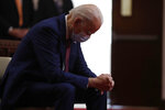 Democratic presidential candidate, former Vice President Joe Biden bows his head in prayer as he visits Bethel AME Church in Wilmington, Del., Monday, June 1, 2020. (AP Photo/Andrew Harnik)