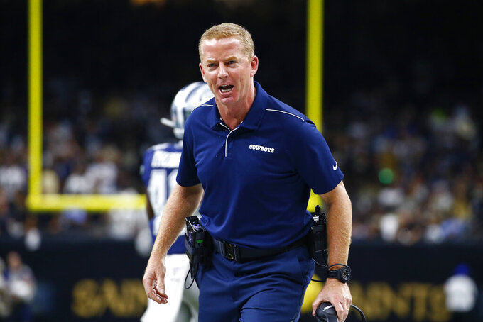 Dallas Cowboys head coach Jason Garrett yells on the sideline in the first half of an NFL football game against the New Orleans Saints in New Orleans, Sunday, Sept. 29, 2019. (AP Photo/Butch Dill)