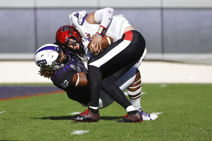 Texas Tech quarterback Henry Colombi (3) is sacked by TCU defensive end Ochaun Mathis (32) during the first half of an NCAA college football game Saturday, Nov. 7, 2020, in Fort Worth, Texas. (AP Photo/Ron Jenkins)