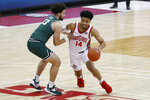 Ohio State's Justice Sueing, right, drives to the basket against Cleveland State's Chris Greene during the second half of an NCAA college basketball game Sunday, Dec. 13, 2020, in Columbus, Ohio.  (AP Photo/Jay LaPrete)
