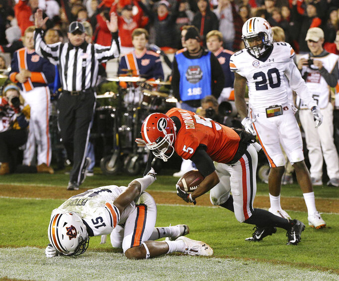 Georgia wide receiver Terry Godwin gets past Auburn defender Jordyn Peters for a 37-yard touchdown catch against Auburn during the second quarter in an NCAA college football game on Saturday, Nov. 10, 2018, in Athens, Ga. (Curtis Compton/Atlanta Journal-Constitution via AP)