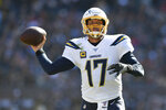 Los Angeles Chargers quarterback Philip Rivers, center, throws a pass during the second half of an NFL football game against the Chicago Bears, Sunday, Oct. 27, 2019, in Chicago. (AP Photo/Paul Beaty)