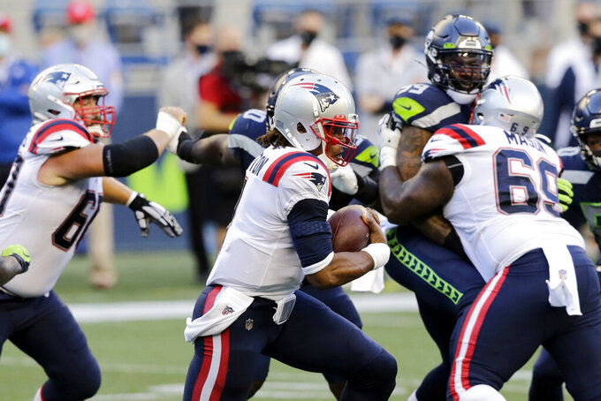 FILE - In this Sunday, Sept. 20, 2020, file photo, New England Patriots quarterback Cam Newton (1) keeps the ball and rushes against the Seattle Seahawks during the first half of an NFL football game in Seattle. A big part of the success the Patriots have enjoyed on offense this season has to do with the discipline of its offensive line. (AP Photo/John Froschauer, File)