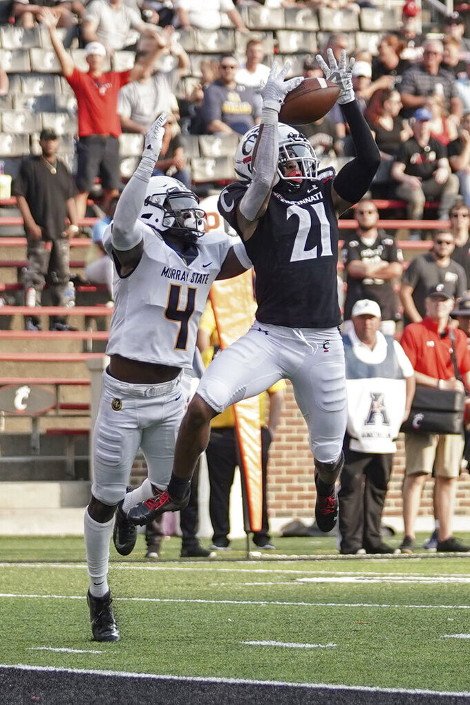 Cincinnati wide receiver Tyler Scott (21) makes a catch for a touchdown during the second half of an NCAA college football game against Murray State, Saturday, Sept. 11, 2021, in Cincinnati. (AP Photo/Jeff Dean)