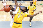 Bradley's Elijah Childs, left, loses control of the ball as Valparaiso's Javon Freeman-Liberty (0) defend during the second half of an NCAA college basketball game in the championship of the Missouri Valley Conference men's tournament Sunday, March 8, 2020, in St. Louis. Bradley won 80-66. (AP Photo/Jeff Roberson)