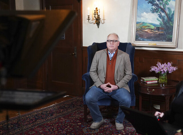 Minnesota Gov. Tim Walz prepares to deliver his delayed State of the State address over YouTube from his residence in St. Paul, Minn., Sunday, April 5, 2020. (Glen Stubbe/Star Tribune via AP, Pool)