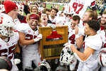 Stanford players celebrate with the Stanford Axe after defeating California in a football game in Berkeley, Calif., Saturday, Dec. 1, 2018. (AP Photo/John Hefti)