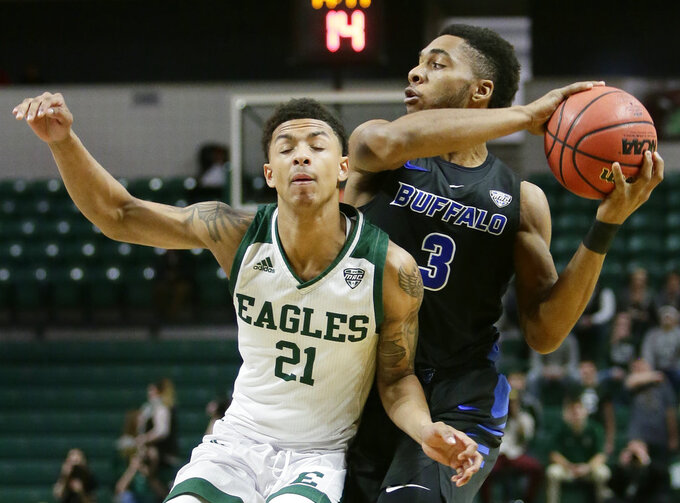 Buffalo guard Jayvon Graves (3) looks to pass the ball against Eastern Michigan guard Kevin McAdoo (21) during the first half of an NCAA college basketball game Friday, Jan. 4, 2019, in Ypsilanti, Mich. Buffalo defeated Eastern Michigan 74-58. (AP Photo/Duane Burleson)