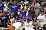 Fans boo as the Houston Astros take the field during the first inning of a baseball game against the Los Angeles Dodgers on Tuesday, Aug. 3, 2021, in Los Angeles. (AP Photo/Marcio Jose Sanchez)