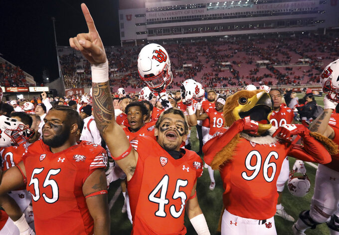 Utah's Nick Ford (55) and Samson Nacua (45) celebrate following their NCAA college football game against Southern California Saturday, Oct. 20, 2018, in Salt Lake City.  (AP Photo/Rick Bowmer)