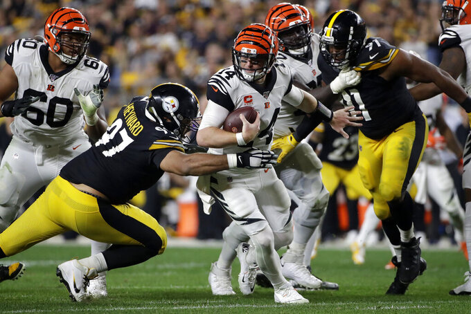 Pittsburgh Steelers defensive end Cameron Heyward (97) sacks Cincinnati Bengals quarterback Andy Dalton (14) during the second half of an NFL football game in Pittsburgh, Monday, Sept. 30, 2019. (AP Photo/Don Wright)
